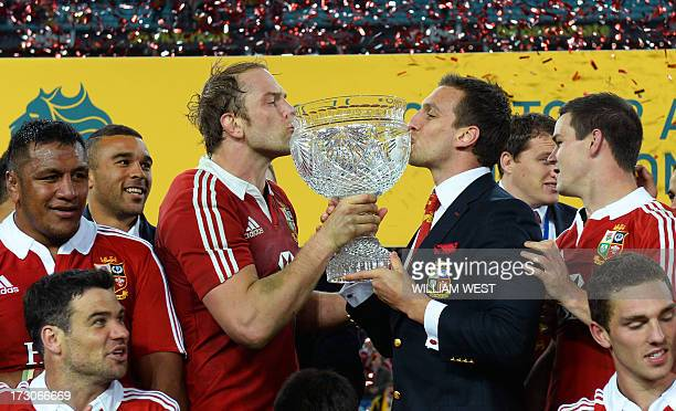 British and Irish Lions captain Alun Wyn Jones and tour captain Sam Warburton kiss the trophy after defeating the Australian Wallabies in the third...