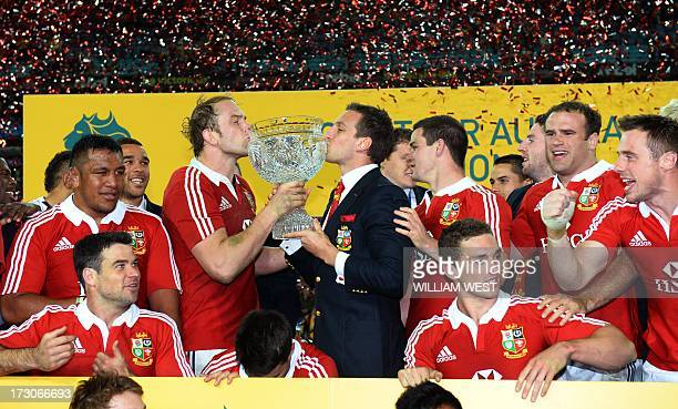 British and Irish Lions captain Alun Wyn Jones and tour captain Sam Warburton kiss the trophy after defeating Australian Wallabies in the third rugby...