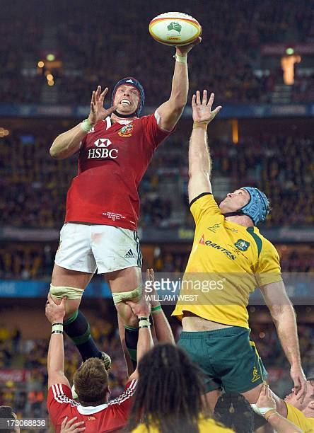 British and Irish Lions captain Alun Wyn Jones takes the line out ball in ahead of the Australian Wallabies captain James Horwill in the third rugby...