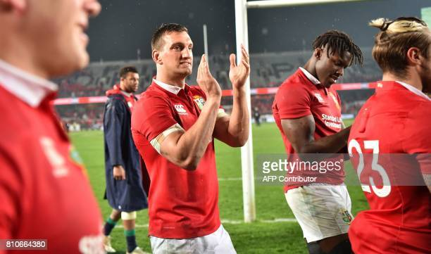 British and Irish Lions captain Sam Warburton and Maro Itoje thank the fans after the third rugby union Test match between the British and Irish...