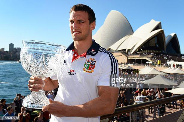 British and Irish Lions captain Sam Warburton holds the Tom Richards Cup in front of the Sydney Opera House the day after defeating the Australian...