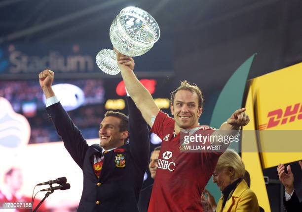 British and Irish Lions captains Sam Warburton and Alun Wyn Jones hold the trophy after the Lions defeated the Australian Wallabies in the third...