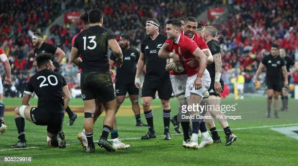 British and Irish Lions Conor Murray celebrates his try with Taulupe Faletau during the second test of the 2017 British and Irish Lions tour at...