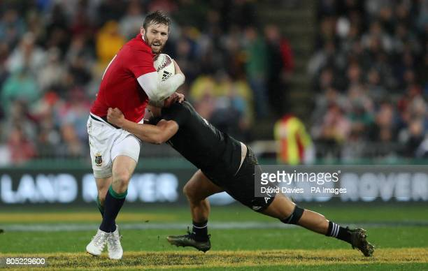 British and Irish Lions Elliot Daly is tackled by New Zealand's Anton LienertBrown during the second test of the 2017 British and Irish Lions tour at...
