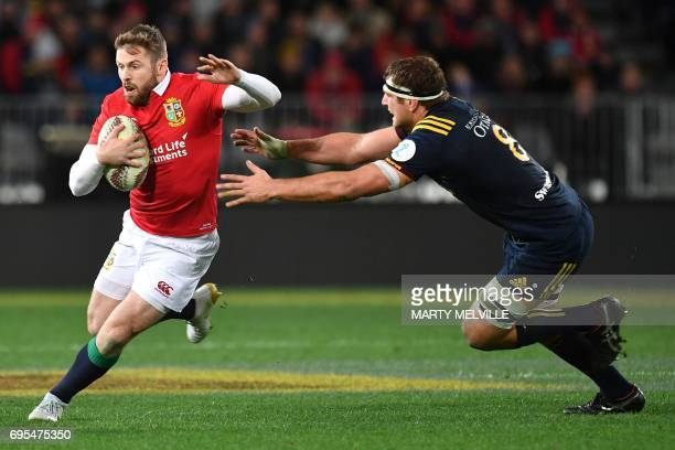 British and Irish Lions' Elliot Daly is tackled by Otago Highlanders' captain Luke Whitelock during the rugby union match between the Otago...