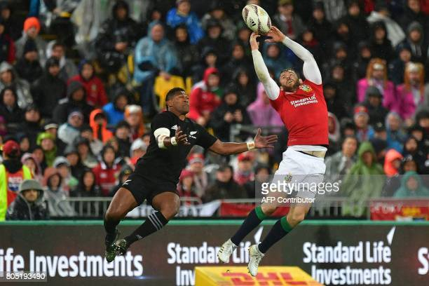 British and Irish Lions' Elliot Daly jumps for the ball with New Zealand All Blacks' Waisake Naholo during the second rugby union Test between the...