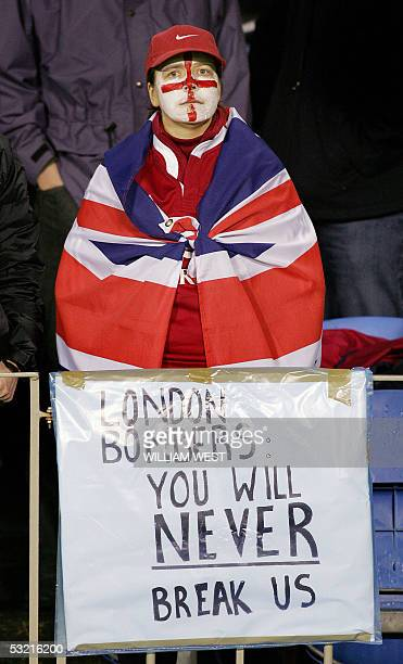 British and Irish Lions fan displays a banner against the London terror attacks before the third Test match against the New Zealand All Blacks played...