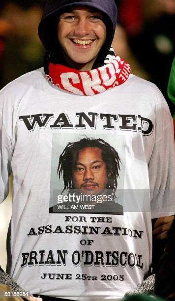 British and Irish Lions fan wear a tshirt with a photo of All Black captain Tana Umaga and a 'Wanted' sign during the Lions match against Manawatu in...