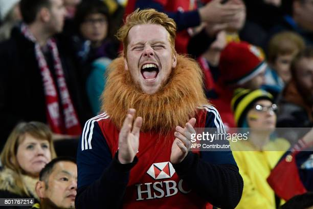 British and Irish Lions' fans celebrate a try during the rugby union match between the Wellington Hurricanes and British and Irish Lions at Westpac...