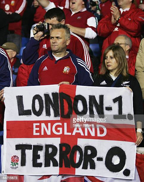 British and Irish Lions fans hold up a banner for the London bomb victims before the third test match between the New Zealand All Blacks and the...