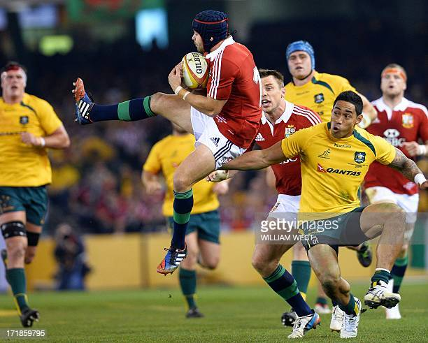 British and Irish Lions fullback Leigh Halfpenny catches the high ball as Australian Wallabies centre Christian Leali'ifano prepares to tackle in the...