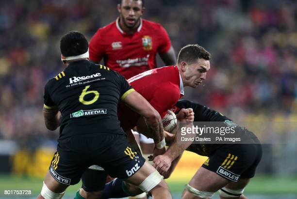 British and Irish Lions' George North is tackled by Hurricanes' Vaea Fifita during the tour match at the Westpac Stadium Wellington
