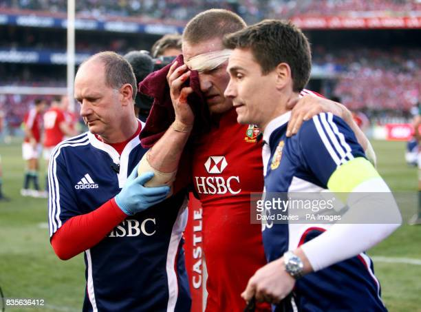 British and Irish Lions Gethin Jenkins is lead from the field by Dr James Robson and Gary O'Driscoll with a fractured cheek bone during the Second...