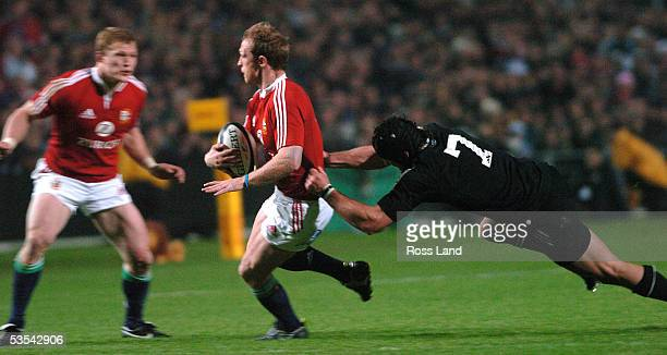 British and Irish Lions halfback matt Dawson is tackled by Marty Holah as Josh Lewsey looks on during the NZ Maori 1913 win over the British Irish...