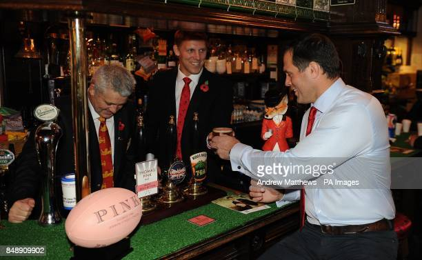 British and Irish lions head coach Warren Gatland poses with Lewis Moody and Martin Bayfield during the launch of the Thomas Pink collection at the...