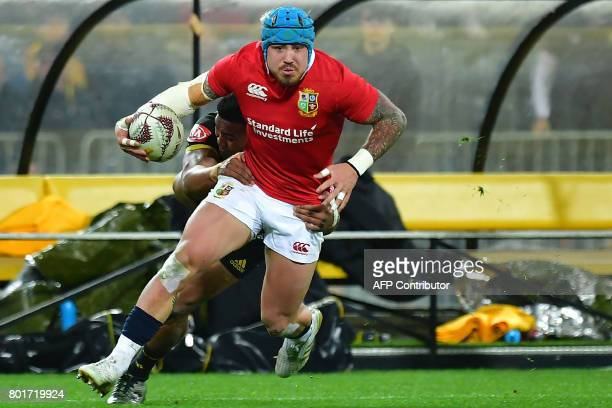 British and Irish Lions' Jack Nowell is tackled by Wellington Hurricanes' Julian Savea during the rugby union match between the Wellington Hurricanes...