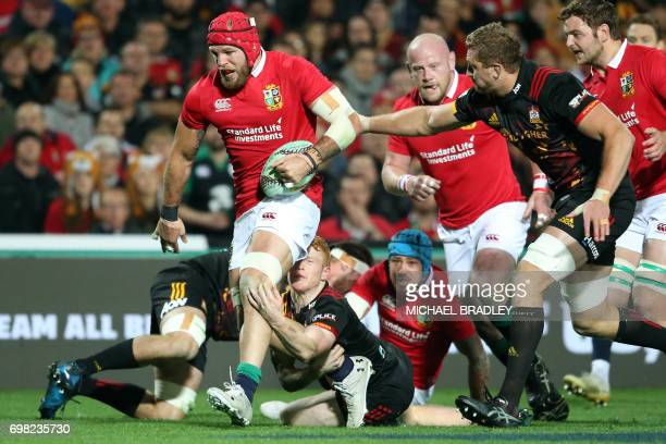 British and Irish Lions' James Haskell is tackled by Waikato Chiefs' Finlay Christie during the rugby match between the British and Irish Lions and...