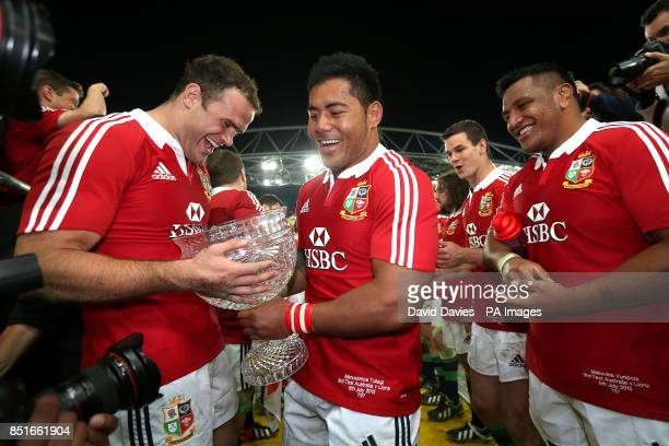 British and Irish Lions' Jamie Roberts Manu Tuilagi and Mako Vunipola celebrate with the trophy after the match