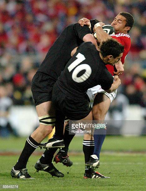 British and Irish Lions jason Robinson is crunched by New Zealand All Blacks Ali Williams left and Daniel Carter in the second rugby test match at...