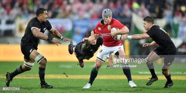 TOPSHOT British and Irish Lions' Jonathan Davies is tackled by New Zealand All Blacks' Jerome Kaino Sonny Bill Williams and Beauden Barrett during...
