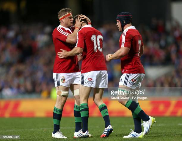 British and Irish Lions' Jonathan Sexton celebrates scoring a try with teammates Sean O'Brien and Jamie Heaslip