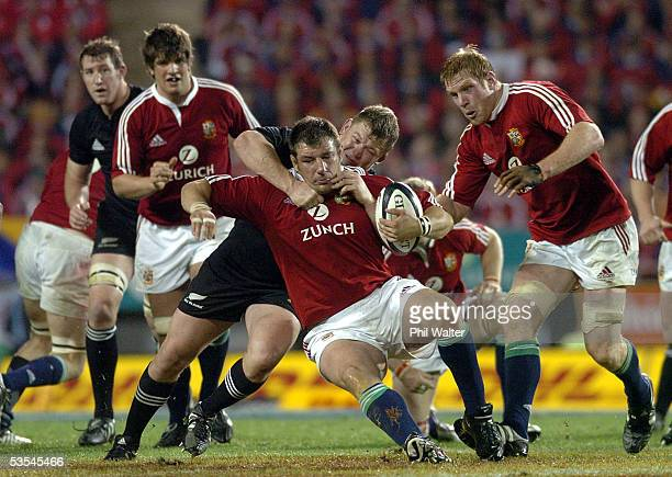 British and Irish Lions Julian White is tackled by All Black Greg Somerville in the third and final rugby union test match played against the All...
