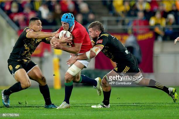 British and Irish Lions' Justin Tipuric is tackled by Wellington Hurricanes' Ngani Laumape and Callum Gibbins during the rugby union match between...