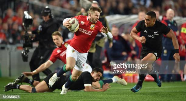 British and Irish Lions left wing Elliot Daly is tackled by New Zealand's inside centre Ngani Laumape during the third rugby union Test match between...