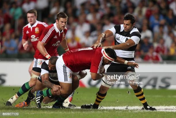 British and Irish Lions' Mako Vunipola tries to break through the Barbarians defence