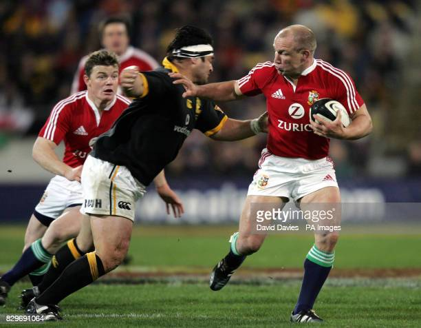 British and Irish Lions' Neil Back hands off the tackle of Wellington's Joe McDonnell