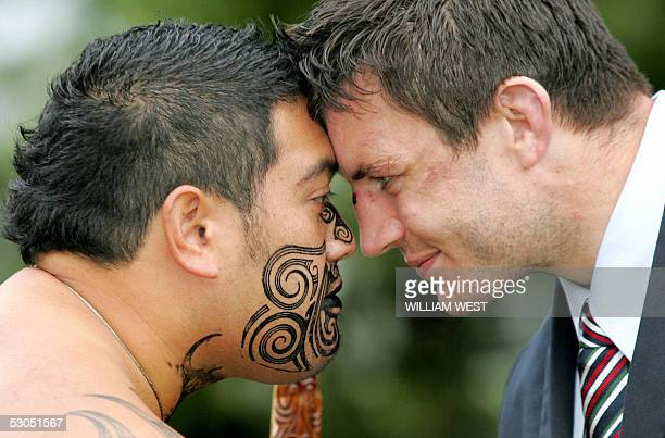 British and Irish Lions number 8 Martin Corry presses noses with a Maori warrior in a traditional Maori welcome called a 'hongi' during a visit to...