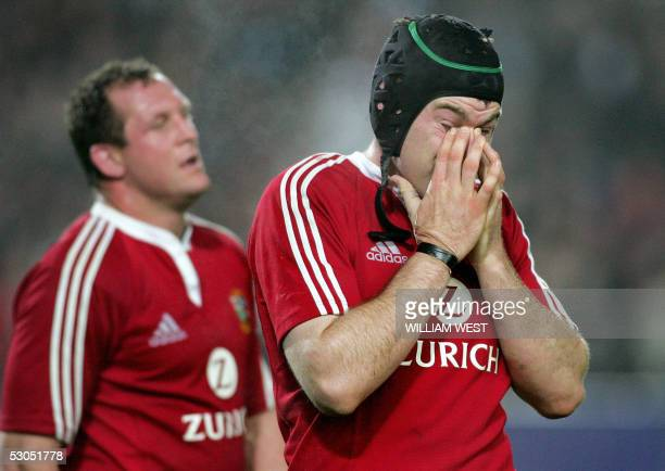British and Irish Lions number 8 Michael Owen and Richard Hill look dejected as they leave the field after losing to the New Zealand Maori team in...