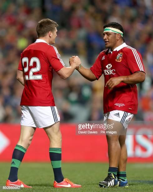 British and Irish Lions' Owen Farrell celebrates his try with teammate Mako Vunipola