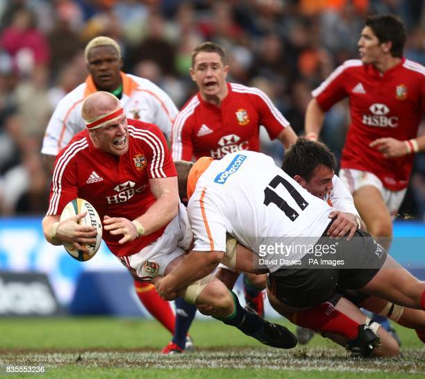British and Irish Lions' Paul O'Connell is tackled by Free State Cheetah's WP Nel
