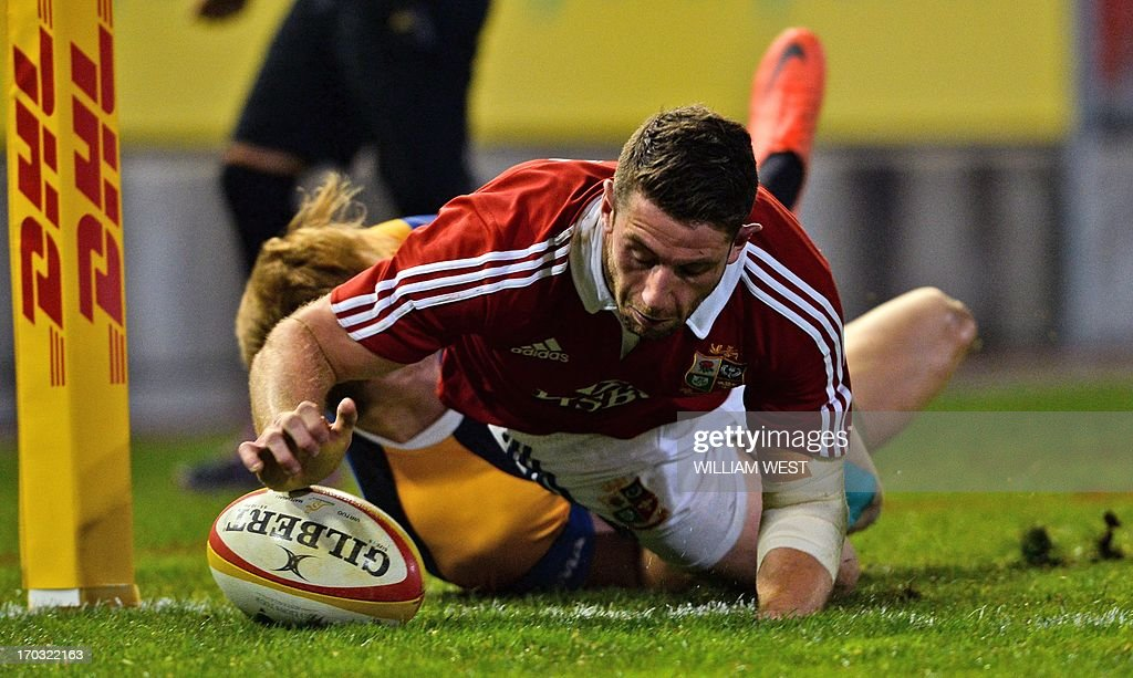 British and Irish Lions player Alex Cuthbert scores the team's first try against a Combined Country team during their tour match in Newcastle on June 11, 2013. AFP PHOTO / William WEST IMAGE