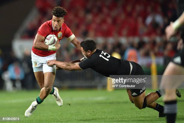 British and Irish Lions player Anthony Watson is tackled by New Zealand's player Anton LienertBrown during the third rugby union Test match between...