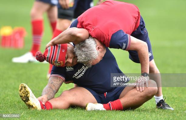 British and Irish Lions player Kyle Sinckler gets treatment as he takes part in the captain's run ahead of the first rugby Test in Auckland on June...