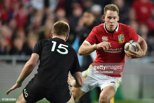 British and Irish Lions player Liam Williams runs towards New Zealand's Jordie Barrett during the third rugby union Test match between the British...