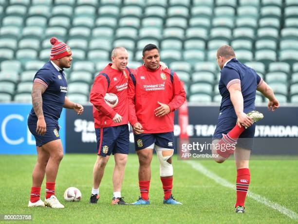 British and Irish Lions players Kyle Sinckler Mako Vunipola and Ken Owens take part in the captain's run ahead of the first rugby Test in Auckland on...