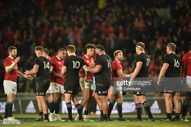 British and Irish Lions players line up to shake hands with New Zealand All Black players after their Test match between New Zealand and the British...