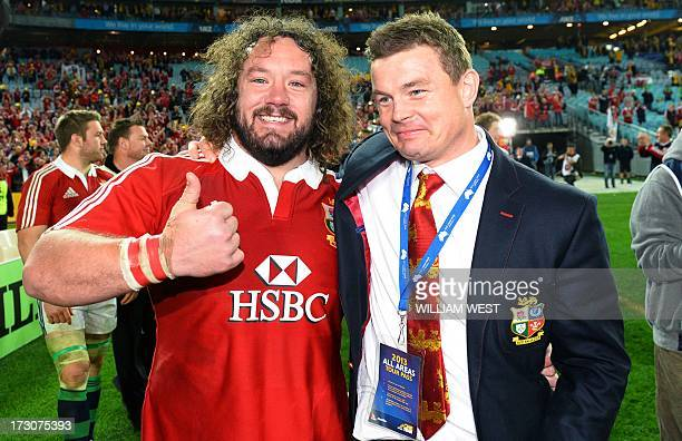 British and Irish Lions prop Adam Jones and center Brian O'Driscoll celebrate after victory of the Australian Wallabies in the third rugby Test match...