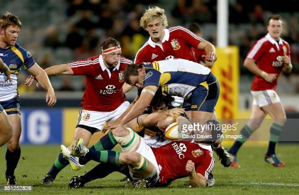 British and Irish Lions' Sean O'Brien and ACT Brumbies' Ruan Smith in action