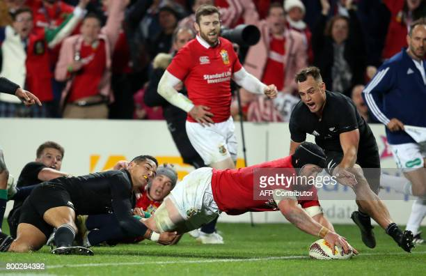 British and Irish Lions Sean OÕBrien dives over to score a try during their Test match between New Zealand and the British and Irish Lions at Eden...