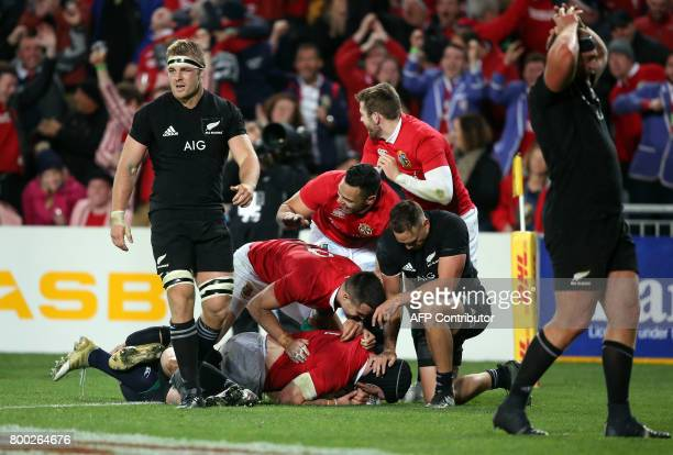 British and Irish Lions Sean O'Brien dives over to score a try during their Test match between New Zealand and the British and Irish Lions at Eden...