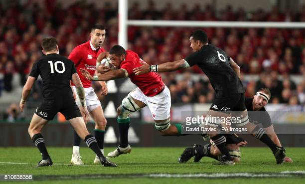 British and Irish Lions' Taulupe Faletau lis tackled by New Zealand's Jerome Kaino during the third test of the 2017 British and Irish Lions tour at...