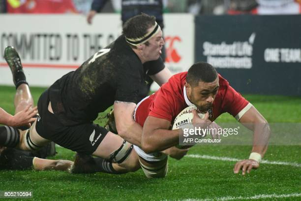 British and Irish Lions' Taulupe Faletau scores a try as he is tackled by New Zealand All Blacks' Brodie Retallick during the second rugby union Test...