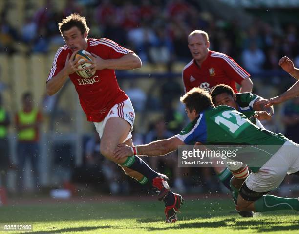 British and Irish Lions' Tommy Bowe breaks through the Royal Highfeld XV defence to score his sides first try of the game and of the tour under the...
