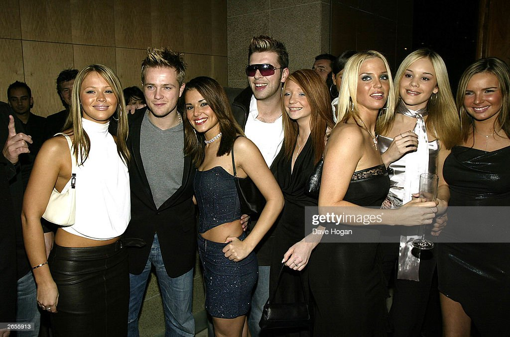 British and Irish pop stars (L-R) Kimberley Walsh, Nicky Byrne, Cheryl Tweedy, Mark Feehily, Nicola Roberts, Sarah Harding and Nadine Coyle of the pop groups 'Girls Aloud' and 'Westlife' attend the 'Unbreakable' album launch at the Zuma Restaurant on November 11, 2002 in London.
