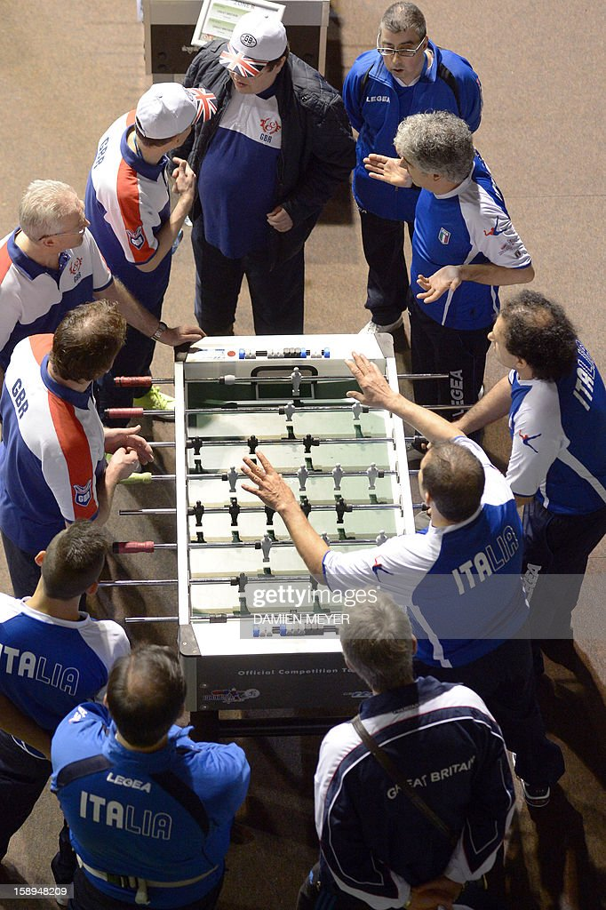 British (L) and Italian (R) competitors react during the ITSF 2013 table soccer (aka babyfoot) World Cup on January 4, 2013 in Nantes, western France.