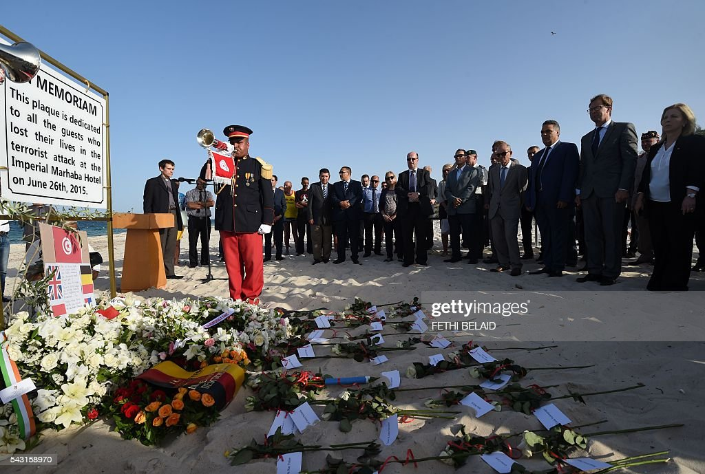 British and Tunisian officials attend on June 26, 2016, a ceremony in memory of those killed a year ago by a jihadist gunman in front of the Riu Imperial Marhaba Hotel in Port el Kantaoui, on the outskirts of Sousse south of the capital Tunis. Tourists fled in horror on June 26, 2015 as a Tunisian gunman pulled a Kalashnikov rifle from inside a furled beach umbrella and went on a shooting spree outside the five-star hotel. 30 Britons were among 38 foreign holidaymakers killed in the attack. / AFP / FETHI